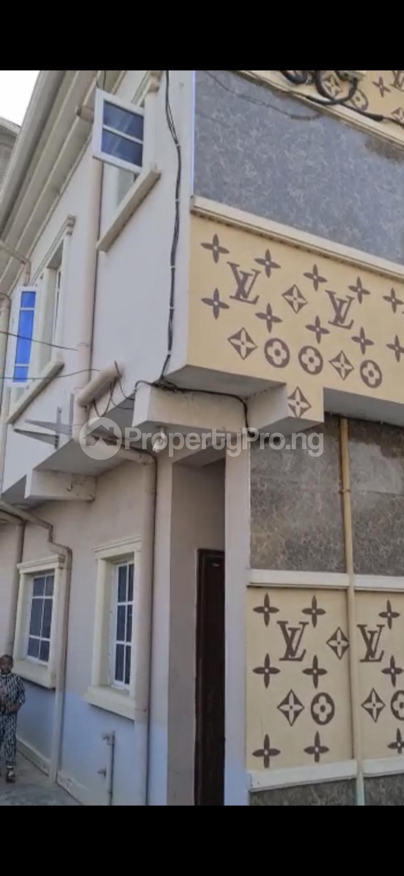House for sale Raymond opara estate  Ago palace Okota Lagos - 1