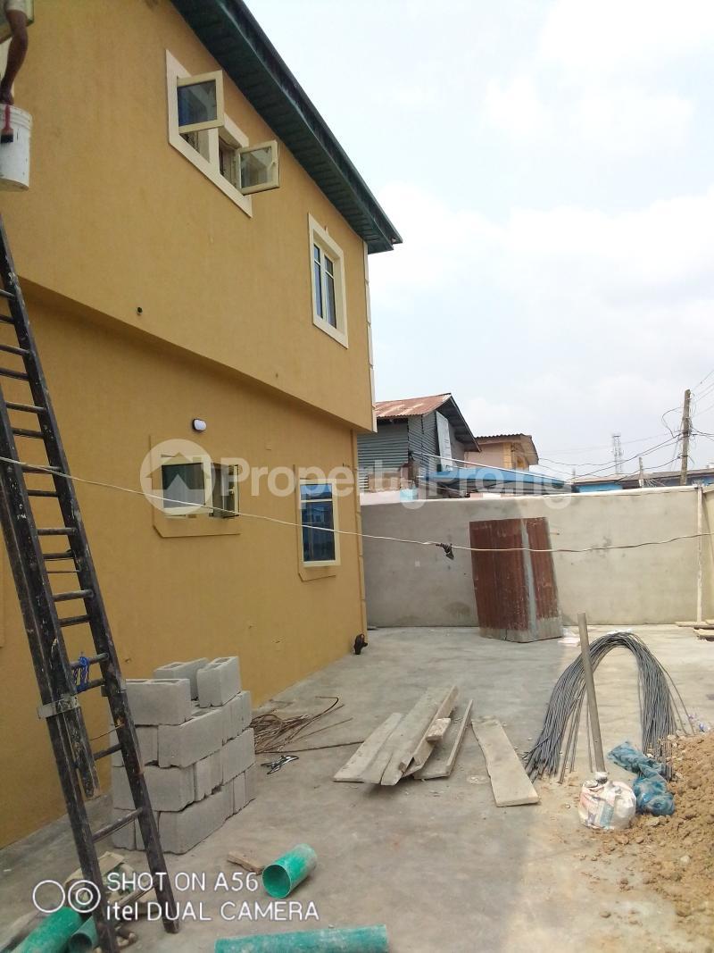 2 bedroom Blocks of Flats House for rent Akowonjo Akowonjo Alimosho Lagos - 16