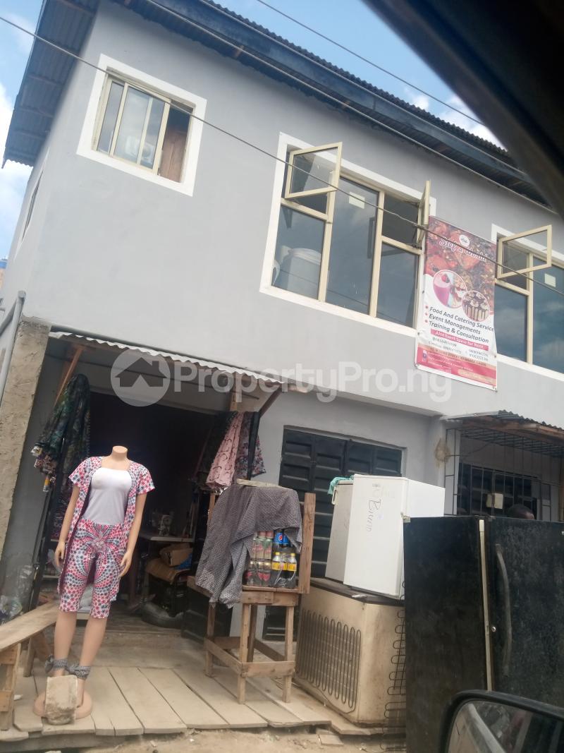 Shop Commercial Property for sale Ik dairo street Lawanson Surulere Lagos - 0
