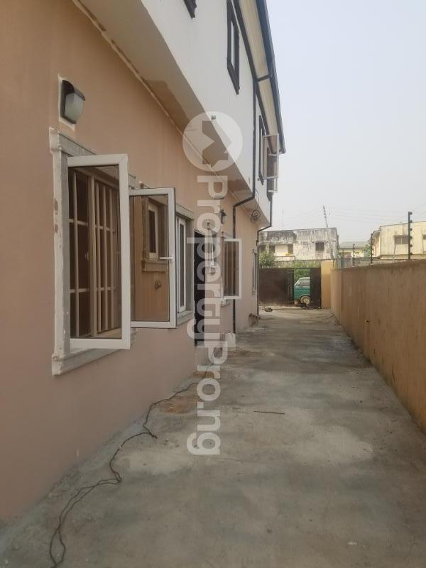 2 bedroom Terraced Duplex House for rent ore close off stop over  Ajao Estate Isolo Lagos - 11