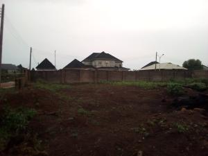 Land for sale 100 by 100 Land size just beside Best  Jinsa Garden and  Event Centre Along Ugo Benedit (Ugo ben) Street off  Aruogba Oredo Edo