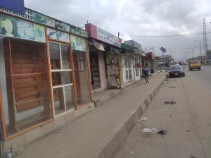 Shop Commercial Property for sale Ago palace way Ago palace Okota Lagos
