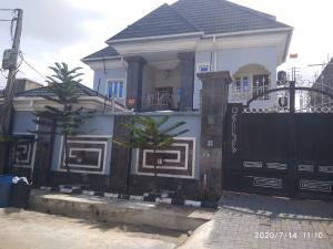 10 bedroom House for sale Tilled road  Ago palace Okota Lagos