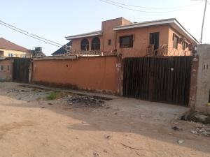 Blocks of Flats House for sale Off Marcity bus stop Ago palace Okota Lagos