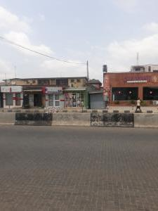 Commercial Land for sale By Dominos Pizza Directly On Ago Palace Expressway Ago palace Okota Lagos