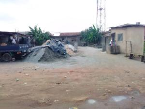 2 bedroom Mixed   Use Land Land for sale Eng. Oyindamola Street,  2nd juction. Governors road Ikotun/Igando Lagos