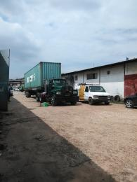 Warehouse Commercial Property for sale By 7up on major commercial road Oregun Ikeja Lagos