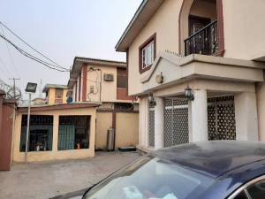 9 bedroom Detached Duplex House for sale Directly along the tarred Bayo Oyewole Street, by Balogun Bus-Stop, Ago palace Okota Lagos