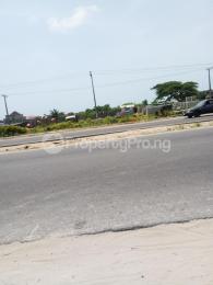 Commercial Land Land for sale Directly along Lekki-Epe expressway, around Abijor GRA, Abijo Ajah Lagos