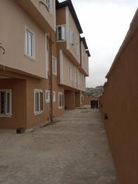 3 bedroom Terraced Duplex House for rent Nelson Cole estate off iju road via college road. Iju Lagos