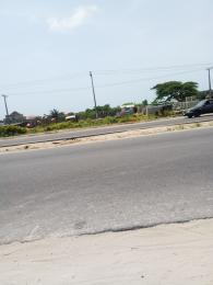 Commercial Land Land for sale Directly along lekki-epe expressway, Abijo GRA Abijo Ajah Lagos