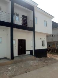4 bedroom Semi Detached Duplex House for sale Sharing fence with Berger yard Life Camp Abuja