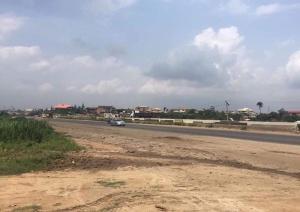 Industrial Land Land for sale beside Compass newspaper lagos ibadan express way Isheri North Ojodu Lagos