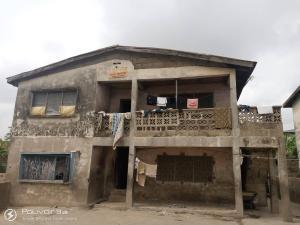 Warehouse for sale Olugbesan Lane,bodee Molete Molete Ibadan Oyo